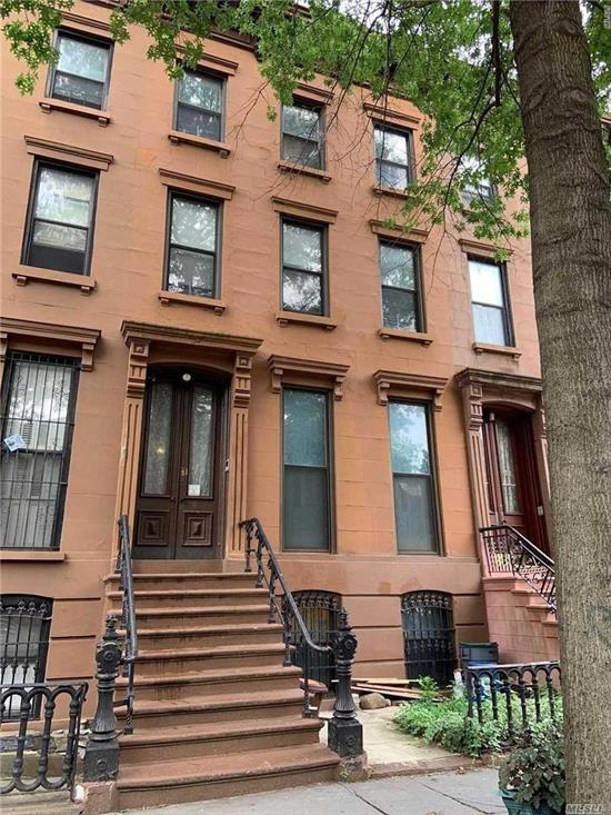 Measuring 20 feet wide, this handsome brownstone is situated on a leafy street in the heart of Clinton Hill. You are located right in the vicinity of Pratt Institute, the prestigious just a few steps from Myrtle Avenue, and conveniently near restaurants, cafe's, shops, soon to be Startbucks, and public transportation. Sprawling over 3300 square feet of living space, not including the 750 square feet of cellar space, here we have the renter's duplex unit over the owner's garden duplex apartment.