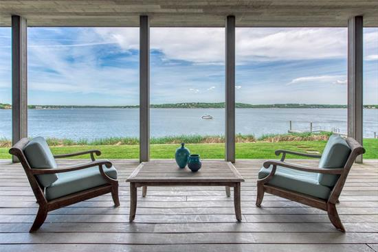 Peaceful Perfection on Peconic Bay. This Open Concept Contemporary Treasure Reflects Simplicity in Design at its Finest.  Stunning Views of Shelter Island Welcome You as You Enter the Great Room Foyer. Clean Lines and Minimalist Architecture with Attention to Detail at Every Turn Creating a Unique and Tranquil Living Experience. Come Discover Serenity.