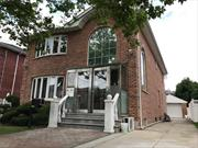 Beautiful Duplex Apartment in A Brick House Was Built In 2008. 1st Floor: Kitchen, Dining Area and 1/2 Bath. 2nd Floor: Living Rm, 3 Bedrooms and 2 Full Baths. Full Finished Huge Basement with Washer & Dryer and 1/2 Bath. Total of 3 Bedrooms, 3 Baths. Private Driveway For 3 Cars. Use of Back Yard. Hardwood Floor, Granite Kitchen Counter Top, Stainless Appliances, Tile Floors in All Baths. Central Air and Heat, 6 Surveillance Camera were Installed and Ready to be Connected. School District #26.