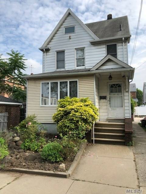 Detached legal two family, currently used as one family. Can easily be converted back to a two family. Conveniently located near major highways, public transportation, shopping, schools - PS 79 & JHS 185. Property offered as is.