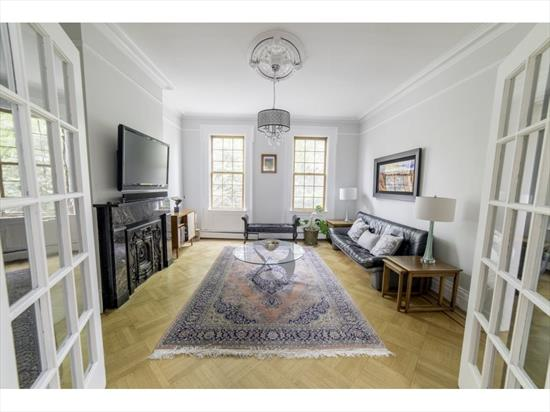 Unique historic four-story, two-family brownstone with five bedrooms, three bathrooms and a private two-car garage located in desirable downtown Jersey City's Harsimus Cove Historic District, only five minutes from Hamilton Park and eight minutes from the Grove Street PATH, providing connectivity to midtown and downtown in minutes. Originally constructed in the mid-1800's as part of Doctor's Row, this gracious home features a wide 20.83'X100' lot and a lush South facing front garden complete with a specimen Magnolia tree and a self-irrigation system. Offering nearly 3000 square feet of interior living space, the home is currently configured with an owner's triplex and a garden level rental apartment, last leased for $2000 per month. The home's main entrance features a spacious foyer and magnificent double parlor rooms, perfect for entertaining with soaring 10' ceilings and an impressive collection of period details including black marble fireplace mantels, plaster crown molding and medallions, French doors and original oak hand-hewn parquet floors. The private two-car garage behind the house is accessed by going through the charming, private rear courtyard garden canopied by Wisteria vines. Heading upstairs, the distinctive windowed stairwell is highlighted by original lincrusta wall covering and a curved mahogany bannister. The second level of the owner's triplex features a spacious eat-in kitchen with pantry, and a large bedroom spanning the width of the home and is accented by a soapstone fireplace mantle, an original plaster archway and an en-suite full bathroom. The top level of the home features a wall of exposed brick in the stairwell along with exposed timber beams and contains three bedrooms, one of which is currently being used as an office, and one full bathroom. The garden level rental apartment is approximately 750 SF with one bedroom, one-bathroom, separate utilities, a washer/dryer and dishwasher for maximum rental appeal. The home has four separate h