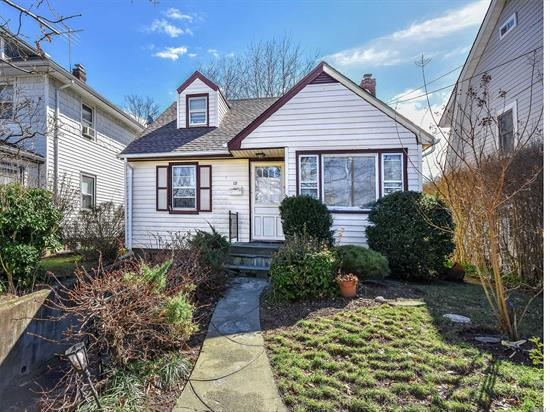 Great opportunity to invest in this cape cod home that is conveniently located close to Town & Train.... Commuters dream location.  New Roof, upgraded electric, gas heat.... Home needs work & being sold As Is