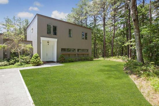 Freshly Renovated Contemporary , very unique floor plan with Great Room and style, Artist's own home, 2 Full baths, 4 car Garage and workshop with heat. 2.13 Acres of private land surrounded by parklands. Bike trails. Excellent location for South and North Forks, minutes to LIE.
