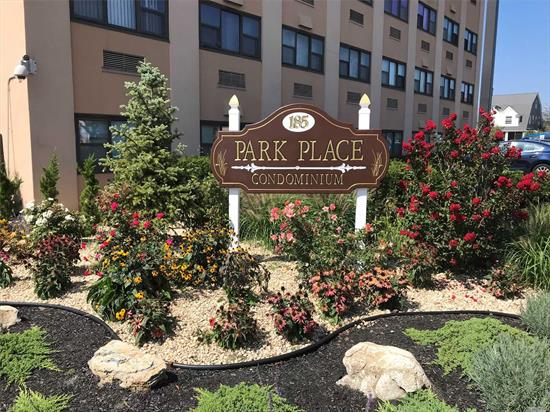 Bright 2 bedroom, 1.5 bath condo in desirable Park Ave. building. Unit has a terrace. Tile floors, updated kitchen, good closet space, washer/dryer in unit. Building has parking, pool, gym, 24 hour security/concierge. Walk to all: Long Island Railroad, restaurants & shops, library, recreation center and beach. No pets. Park Place Condominium.