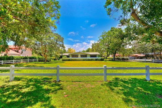 Remodel Or Build New On A Full Acre Of Land Just West Of The University Of Miami. The Sprawling House Still Carries Its 1950'S Charm And Character But Is Now Ready For A New Family To Renovate Or Enjoy A Brand New Estate. The Property Is Situated On A Prime Location At The End Of A Beautiful Street, In A Family-Friendly Neighborhood. The Current Home Includes A Screened-In Pool With Covered Patio, Terrazzo Floors In The Original Living Areas And Hardwood Floors Throughout The 4-Bedroom Wing, All Protected By Carpeting. Other Features Include His And Her Family Rooms, A Formal Dining Room, Hurricane Shutters, 2-Car Garage And A Separate Guest Bedroom With Cabana Bath Off The Kitchen. This Property Has Had Only Two Owners And You Can Be The Third!