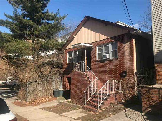 Calling all contractors and investors. Price Reduced for quick sale. Charming one family w/garage. In need of total gut renovation. Estate sale must be sold.
