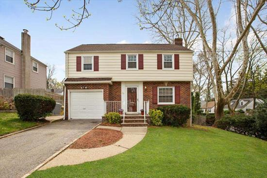 Very well maintained 4 bedroom/1.5 bathroom Colonial on 60x100 corner lot in Teaneck. This inviting home features hardwood floors throughout with living and dining room areas perfect for entertaining. Sunny kitchen, family room and guest bathroom complete the main floor. Top floor comprises 4 bedrooms and one full bathroom. The finished basement has high ceilings and additional space for an office, family room and washer/dryer area. Features include: Central AC, new roof, new water heater(2018), sub pump and french drain. Close to NYC buses, shopping, schools and houses of worship.