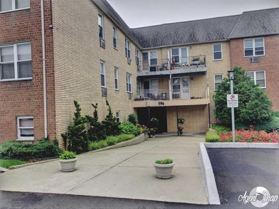 Beautiful Jr 4. Condominium In S. Lynbrook W/ 1 Free Garage Parking Spot! This Top-Floor Condo Boasts An Kitchen w/ Newer Appls, New Light Fixtures, Freshly Painted, Large Lr, Formal Dining Room, King-Size Bedroom & Tons of Closets! Low Common Charges Of Only $304/Mth Incl Heat/Water/Gas/Strg Spot/Ig Pool/1 Parking Spot...Wow! Building Has All Brand New-IG Pool/Driveway/Roof/Boilers & Ldry Rm. Close To LIRR.