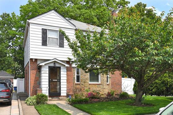 Bayside Hills. Captivating Colonial with Classic details. Fieldstone Fireplace, Crown Moldings, Hardwood Floors. Central Air, G.A.S Heat & Hot Water, 220 Electric, Hi Hats, Open Kitchen/Dining Room w/door to property & Garage. Separate Outside Entrance to Lower Level w/Playroom, study. Prime location close to Bus Stops, Parkways, Bridges, Railroad to N.Y.C, shops, Sports Venues & Fine Dining. School District #26 - PS 203-Oakland Gardens, J.H.S 74-Nathaniel Hawthorne & Benjamin Cardozo High Schools.