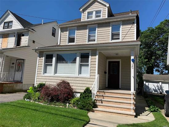 Beautiful 2 Family home on tree line block. All redone, 1st fl, EIK w/ ss applicances, , Liv Rm, Din Rm, Bedrm, Full Bath, Deck shared W/D in basement, Up - EIK, Liv Rm, Bedrm, Full Bath, 2nd Bdrm Up, Full finished Basement w/ Office, Family Room, storage, separate meters, backyard w/ pavers, 1 car garage and private driveway for 5/6 cars, No parking overnight on street. E. Rockaway is 1/2 block away.