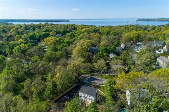 Move Right In To This Exceptional 4 Bedroom Colonial Set On A Private Circle with A Beautiful Back Yard. Amazing Open Airy and Bright Kitchen Flows to Eating Area and Family Room. Gorgeous New Baths. Master Suite with a Walk In Closet. Every Detail Meticulously Thought Out For Today's Lifestyle. Fabulous Private Back Yard for Entertaining. Ideal Location to The Beach, Shopping and Restaurants. Fabulous Quiet Sidewalk Street Bordering the Bay. Gas Cooking & Fplc-Gas on Street.Tax Grievance Filed.