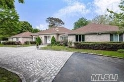 Spectacular Custom Sprawling Ranch On Long Island's Gold Coast ! This Home Is Nestled On 4 Spectacular Acres Of Flat Resort Like Property With A Breathtaking Gunite Pool, Waterfall And An Outdoor Area For Entertaining And Barbecues! It Has 5 Large Bedrooms / 4.5 Bathrooms/ 2 Fplcs And A Wonderful Custom Chef's Kitchen With A Center Island,