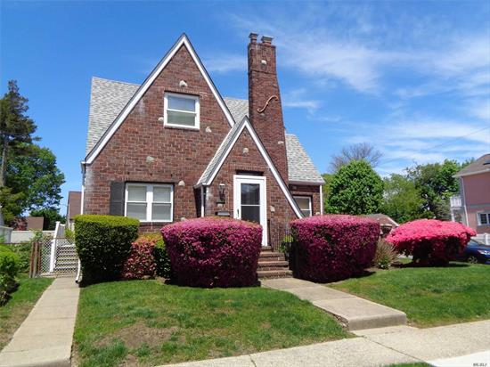 This 4 bedroom, 2 full bath brick Cape can be found on a tree lined street in the Village of Hempstead with Uniondale schools. Great curb appeal corner property with manicured lawns and backyard for entertaining or for kids to play. On entering this house the warmth envelopes you without even turning on the fireplace. Second floor is renovated and has wood floors. Close to schools, parks, shopping, parkways and local entertainment.