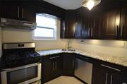 Private Entrance E Model a Granite Eat In Kitchen, Updated Bathroom, Spacious Livingroom,  2 Bedrooms, Full Bath, Washer/Dryer & 3 Air Conditioners. This coop has a bonus room a finished attic with a Skylight,  Enjoy Summer having your own Patio, Easy Access to Express Buses, NYC Buses & LIRR as well as shopping