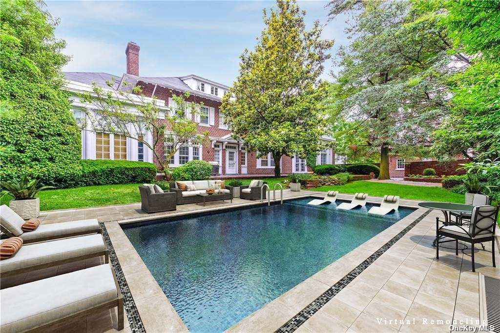 One of a kind magnificent Woodsburgh Village Estate in Woodmere. Breathtaking estate with over 8000 sq ft situated on spectacular landscaped grounds. Exquisite Eat in Chef kitchen, Bkft rm, FDR Rm, Sun Rm, Pantry, Living rm, 3 Powder rms , high Ceilings, ample closet space and extremely bright with oversize windows. The second floor of this magnificent home has a beautiful private master suite, his/her master Ba & walk in closets, private balcony & additional 4 Brs. Third floor had 3 large brs.