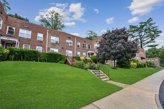 Come See This 2nd Floor, One Bedroom Unit With Large Sunny Rooms, Wood Floors, Lots of Closet Space. All New Windows, New Oven & Bedroom Fan. Shared Bike Room, Laundry Room, & Parking, Garage Can Be Rented. Beautifully Manicured Grounds! Convenient to LIRR, Bus, Shopping, Major Highways, Parks and Beach.