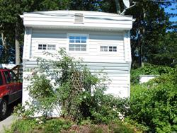55+ Community. A very well kept two bedroom home in a lovely community. Brand new large wood deck for entertaining. Roof was put on in 2015. Two pet maximum. $435 a month for common charges as well as taxes of $799.84 Year without exemptions. Total $501.65 a month. Monthly includes lot rent, water, cesspool, trash/snow removal, shoveling pathway to steps. Two car driveway. 2 Pet Max. Come see what may be your new affordable home.