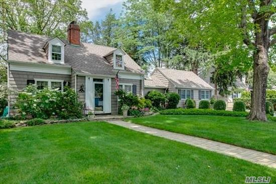 Charm Galore !!!! in this expanded cape with mature lush landscaping. Gorgeous, sunny kitchen with adjoining family room and patio overlooking private yard. Wood burning fireplace in living room. Cozy family room with bookcases, Many upgrades including French drain, new roof 2010, new cesspool. Walk to Muttontown Preserve, Must See