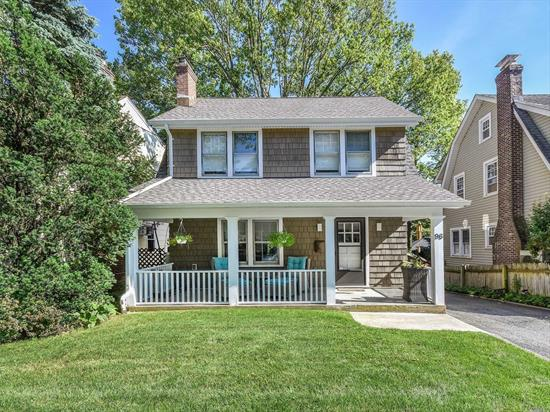 Beautifully Updated Colonial With Open Floor Concept . Large Living Room with Wood Burning Fireplace, New Eat in Kitchen with Sky Light Opening To Dining Room, Solarium Overlooking Back yard, New Bathroom, New Heating, New Central Air, New Hot Water Heater, New Roof with Warranty, Walk Up Attic and Great Location!