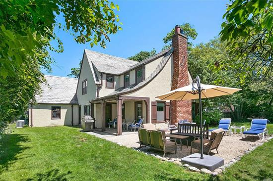 This Stately Southampton Tudor home on .37 acres in the heart of the village within seconds to Ocean beaches and town has lots of natural light this four bedroom home has two and a half baths, dining room , den, living room with fireplace and eat in kitchen , pantry, office on second floor and two car garage . Lush landscaping , covered outside patio .Room for pool , pool house and expansion. Moments to Ocean beaches , village shops and restaurants waiting for you to create your dream home .