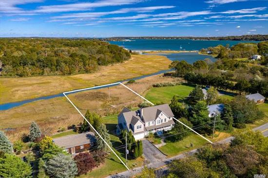 This Panoramic Water View 5 Bedroom home includes an accessory apartment in Peconic Bay Estates - located less than 2 miles from Greenport Village. 2005 complete renovation includes two kitchens, master suites on both floors, Great rooms, hardwood flooring, a fireplace and much more. Picturesque natural setting with unobstructed views to Shelter Island and the ferries. Beautiful lawn and yard area. Town Beach access to enjoy Peconic Bay.