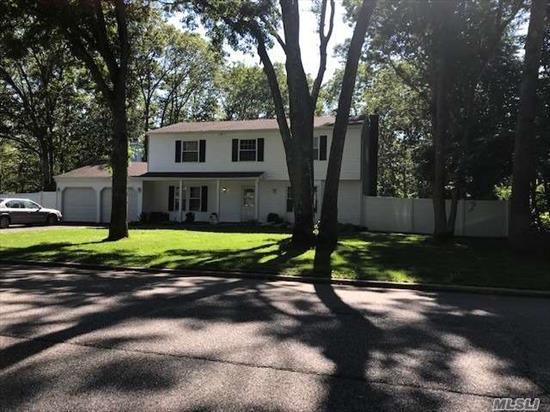 Diamond Center Hall Colonial, Open floor plan, nestled in a country setting. Very large home, Large EIK w/ white cabinets, granite counter tops, Ceramic tiles, HW Floors throughout, Fireplace, all updated bathrooms 2 yrs old, MBR w/Full BA, 2 cement patios, attached cottage for Mom, 2 BR, LR, Bar area, and BA.