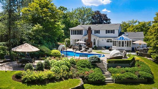 Meticulously Maintained 4 BR, 3 & 1/2 Bath Center Hall Colonial in Syosset School District, Boasts Brand New Wide-Plank Wood Floors, Family Rm, Formal Dining Rm, Kitchen w. Granite Counters & Gas Stove & Stunning Sunroom w. Add. Gas Fireplace. Master BR Suite w. Walk in Closet. Pre-Wired w. Sonos Music System & 5 Zone A/C & 4 Zone Heat. Finished Full Basement Including Half Bath. Country Club-Like Backyard Complete w. Salt Water Pool, Outdoor Kitchen, TV & Personal Putting Green. Will Not Last!
