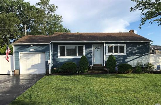 **Fully Renovated Turnkey Home Freshly Painted w/ New EIK, New Siding, and New Stainless Steel Appliances. Beautiful Den w/ Sliding doors to New Over sized Deck, Part finished basement w/ porcelain tiled floors. This is a Must See!!