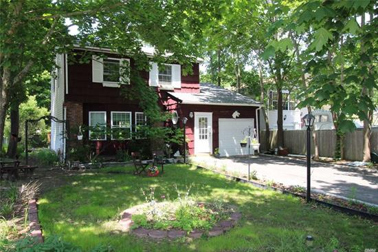 Great Opportunity to Own a Spacious Colonial Home On The South Shore of LI. This Beautiful 4 BR includes a Large LR, and Grand Kitchen & Dining Area along W/2 Full Baths.. There Are Also Hardwood Floors, A Full/Partially Finished Basement, An Attached Garage & Large Backyard. Just Steps from the Forge River and Minutes Away from Marinas and Smith Point Beach, Motivated Seller!