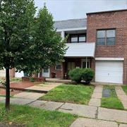 Fabulous Townhouse with 3 Bedrooms, 1 Bathroom, Kitchen, Large L-Shaped Living/Dining Room, Beautiful Hardwood Floor, Covered Balcony, Attached Garage, Private Back Yard For Entertaining. This home is zonded R3-2 (TWO FAMILY).