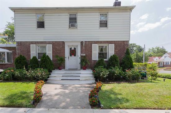 Beautiful True Center Hall Colonial. Excellent condition Spacious and bright home. School district 26. Close to all