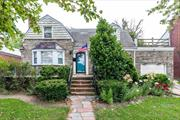 Center Hall Cape Situated On Large Beautiful Grounds. This Home Features Living Room With Fireplace, Formal Dining Room, Kitchen. The Second Floor includes 2 Large Bedrooms and Full Bathroom. Full Basement. Large Backyard. Front Inground Sprinkler System. 10 Minute Walk To LIRR, 42 Minutes to Penn Station, 38 Minutes to Atlantic Terminal. Home Needs Updating But Has A Lot Of Potential.