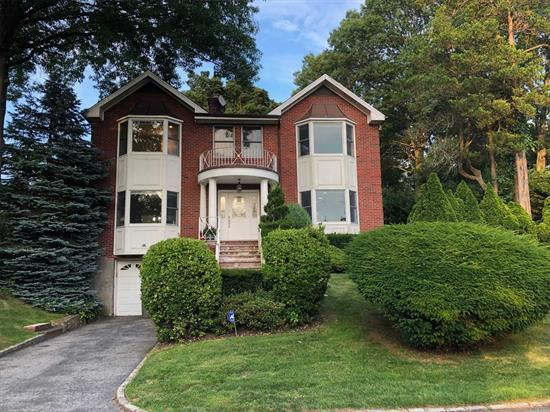 Lovely Renovated Brick Colonial. 5 Bedrooms, 3 Full, 1 Half Bath. Updated Eat-in-Kitchen, Formal Dining Room w/Fireplace, Living Room w/Fireplace. Partially Finished Basement. Hardwood Floors Throughout. Close Proximity to Town and LIRR.