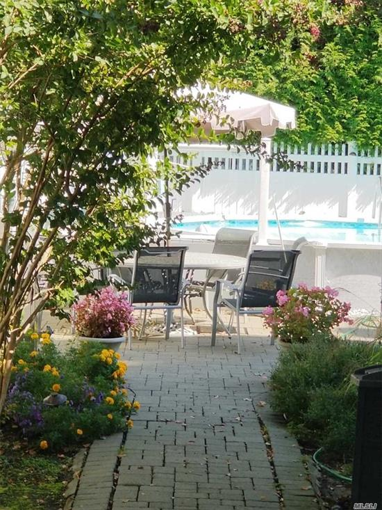 Huge Colonial features 4 BIG bedrooms & 3 full baths. Master suite has 2 large closets and an ensuite master bathroom w/floor to ceiling tiling. Main floor has a formal dining room, elegant living room with working fireplace, large den w/ sliding glass doors that lead to beautiful East facing gardens & lounging areas, full kitchen + sunny kitchenette opens to a porch, a sunken swimming pool, grilling & patio dining area, and space for sunbathing. Attached garage+4 car driveway & mud room