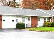 Beautiful highly sort after BARONET model, close to Clubhouse, pool, & amenities. Spacious EIK with newer wood cabinets, open floor plan, living room & 2 bedrooms - carpeted, double pane insulated windows, comfy enclosed porch offers views of natural wooded setting. Plus, 1 car garage. Everything you must have! Privacy abounds here! Leisure Village has a one (1) pet limit policy.