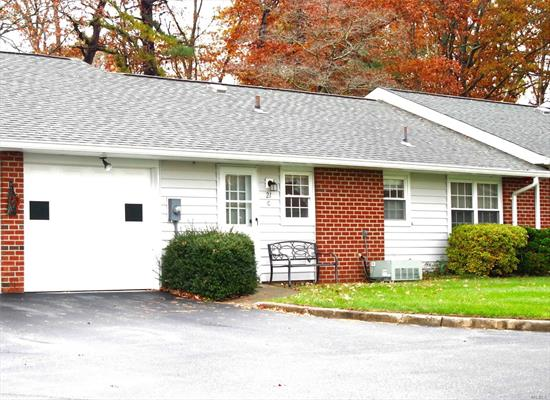Beautiful, Sun drenched, highly sort after BARONET model, near Clubhouse, pool, & amenities. Spacious EIK with newer wood cabinets, garage accessible from kitchen, new garage door, living room & 2 bedrooms - W to W carpets, double pane insulated windows. Comfy enclosed porch provides views of natural wooded setting. Near all amenities, highways, doctors, shopping, restaurants, wineries! The must haves! Privacy abounds here! Leisure Village has a one (1) pet limit policy.  Common Charges: $345