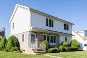 Bright airy colonial located on tree lined street in Franklin Square.