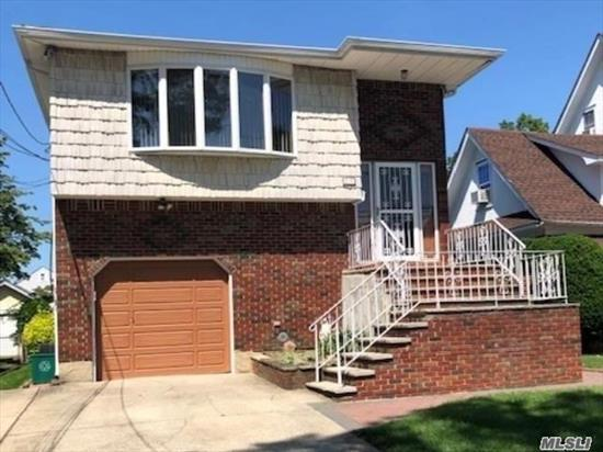 Over-Sized Hi-Ranch with Full Basement. Newer Kitchen, Newer Roof, 2 Baths, 4 Bedrooms, Den w/Fireplace, Over 2000 sq ft of Living Space plus Basement! Great for Mother/Daughter with Proper Permits.