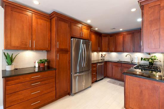 You'll love this stunning 2 Bedroom home located in a premier location just a few blocks from the PATH train. This open concept unit features lots of storage space (incl. 2 walk in closets), high ceilings, and recessed lighting in a boutique elevator building. Enjoy your private terrace, perfect for entertaining and situated off of the living space with glass doors that provide an abundance of sunlight throughout the day. The renovated, inviting kitchen includes dark wood cabinetry with lighting underneath, granite countertops, ample amounts of storage, and stainless steel appliances. The home also features custom blinds in the bedrooms, central A/C, and your own washer/dryer (along with the laundry room in the basement). The basement also contains private, gated storage space for the unit and the entrance to the beautifully maintained shared common yard. This is a commuter's dream with a bus stop on the same street and a short walk to the PATH with the convenience of a municipal parking garage only a block away.