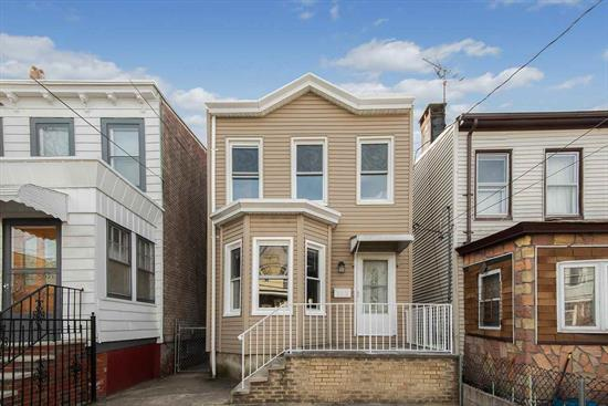 Completely renovated 2 bed/1 bath colonial w/11ft ceilings. Modern designed kitchen, full spacious basement and open concept dining and living area. 537 sq ft. Basement can be used for extra living space. 2 car driveway! Only 9 blocks from light rail station to NYC!