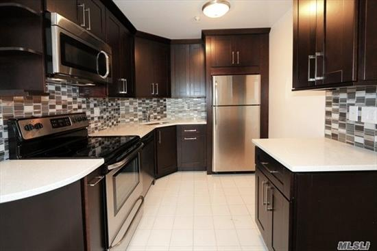 Brand New And Totally Renovated Spacious Condo With Hardwood Floors New Kitchen W/Stainless Steel Appliances, Two New Bathrooms, Tons Of Closet Space Balcony, Doorman, Live In Super And Garage Parking. Very Desirable Area, Just Blocks to LIRR, Town, Shopping, Restaurants and Parks.