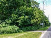 A pristine wooded 12.75 acre parcel on a highly visible North Fork location. A rare opportunity for organic farming, farm to table venture or small subdivision. Development Rights Intact.