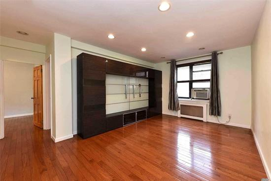 Large 2 Br Coop Unit, Feature Hardwood Flooring, recently Renovated the whole apartment , new modern Kitchen, new Bathroom, Both Windows In Kitchen And Bathroom. Formal Dining Area, Spacious Living Room With garden view,  Well Maintained Building With Newly Updated Elevator, Gym, Storage Room, Laundry Room, Meeting Room.., Sit On One Of The Best Quiet Block Of North Flushing, Very Low Maintenance Cover All Utilities, Very Short Wait List For Parking Space, Close To All Bus Line, , Etc...