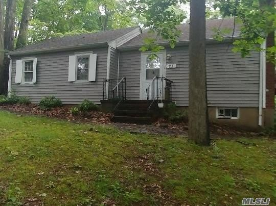 This home is just waiting for someone to make it their own. Needs TLC. Detached 2 car garage, living room with stone fireplace and walls of glass overlooking wooded property. Separate building on property is being used as a woodwork shop but, it could be a studio. Private dead end street. Quiet serenity abound with lush trees surrounding this tranquil home. Bring your decorating ideas.