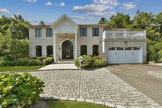 Elegant Brick, Center Hall Colonial set on a magnificent property. Perfect mid-block location. Sonos system, security cameras, CVAC, Built in BBQ. Designer baths. Only the very best in this better than new home! Lower level finished with high ceilings + kitchen (Perfect for entertaining).