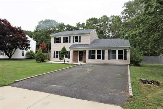 Diamond Renovated Colonial In A Beautiful Neighborhood , Great Mid Block Location, 400sq ft Great Room, New Kitchen with Granite Counter and New Baths, New Oak Flooring, Freshly Painted, Private Yard Backing Woods-Must See Wont Last !!!