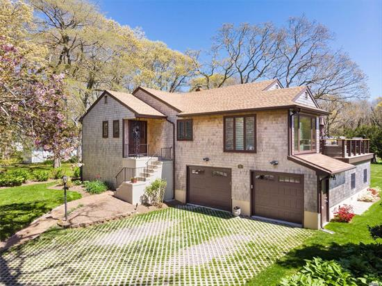 This spectacular waterview/waterfront is a perfect retreat! The updated and professionally decorated interior of this home offers a light and bright open floor plan where you can savor the beautiful water views from many of the rooms. Enjoy the best views in Bay Woods and the Sunrise right on the waterfront deck, from the private deeded beach or from your boat on the private deeded dock. Most balanced and elevated views in Bay Woods!