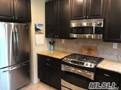 Mint all Updated 3rd floor Unit, New Kitchen W/Granite, New Stainless Appliances, Hardwood Floors, New Bath, Very Spacious, Large Master BR, Recessed Lighting, Beautiful View of Court Yard, New A/C, Laundry Room Plus a Common Patio Area!! RVC Schools, Close to LIRR, Village of RVC and Shopping!! Assigned parking available!! Just Move In!!
