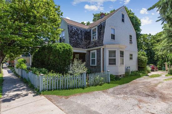 Charming Dutch Colonial In The Heart Of Greenport Village. Steps Away From All Transportation, Restaurants, Etc. Home Features 4 Bedrooms, 2 Full Baths, High Ceilings And Wood Floors Throughout, Large Open Eat-In Kitchen, Cozy Front Porch & Private Rear Deck Overlooking Organic Strawberries and Herbs. Whole House Water Filtration System. One Car Garage.
