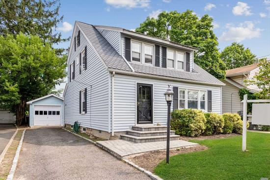 WELCOME HOME! Make it your own, a lovely bright move in ready Colonial in Lynbrook with a huge back yard. Featuring, sitting room, living room w/fire place, formal dining room,  eat in kitchen, 3 season room, 4 beds, 2 bths, basement, attic, long car garage and driveway for 3 cars, original details intact with crown moldings all around. This super clean house is ready to be moved in and enjoyed the comfort of HOME. Near JFK, Belt Pkwy and close to Sunrise Highway. All welcome.